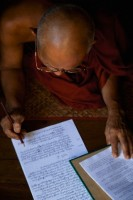 Monk master writing in his journal